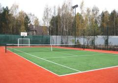Artificial grass for a tennis court, a covering