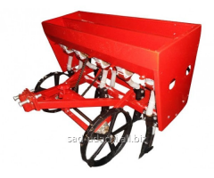 Seeder for the motor-block with the bunker for