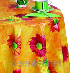Bright orange cloth on a table with gerberas, an