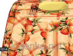 Bright cloth on a kitchen table with oranges, an