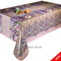 Cloth oil-cloth on a table flowers in violet-red