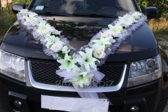 Decoration of the wedding car - a tape on a cowl