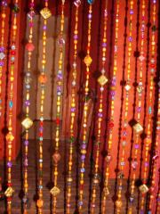 Curtains from bugles. Curtains from beads.