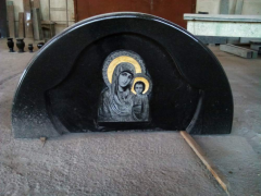 Arch on entrance doors in church with the image of