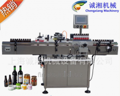 Labeling automatic machine for a round bottle