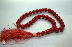 Beads from a red coral of 10 mm.