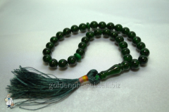 Beads from malachite of 10 mm.