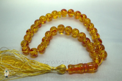Beads from amber (imitation) of 10 mm.