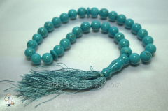 Beads from turquoise of 12 mm.