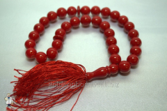 Beads from a red coral of 12 mm.