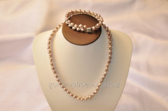 Beads and bracelet from a stone Pearls 107634175