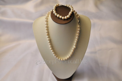 Beads and bracelet from a stone Pearls 107634404