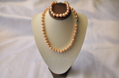 Beads and bracelet from a stone Pearls 107634490