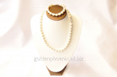 Beads and bracelet from a stone Pearls 107656338