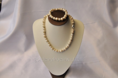 Beads and bracelet from a stone Pearls 107656578