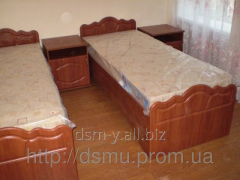 Beds on a metal framework for hospitals, tourist