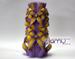 The candle is carved, decorative, height is 200 mm