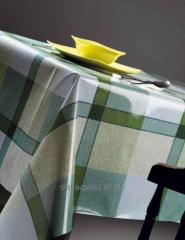 Qualitative oilcloth on a table in green tones,