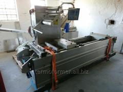Automatic transfer lines for packing in vacuum of