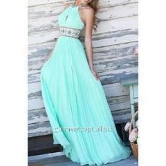 Evening final turquoise dress in a floor with an