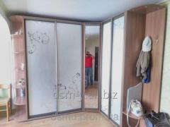 Sliding wardrobe under the order. House furniture