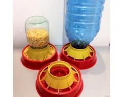 Chickens feeder - a drinking bowl vacuum. Feeding