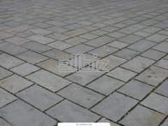 The stone blocks is sidewalk