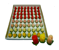 Buds of roses with leaves from marzipan for