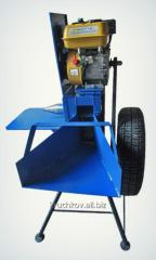 Grinder of branches under the petrol engine