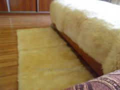 The cape on a sofa, from a sheepskin, 200 cm by 50