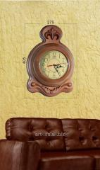 Stylish wooden hours of 40,5 cm x 27,5 cm in size,