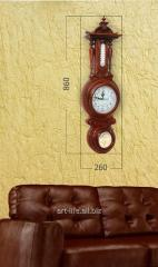 Stylish wooden hours with a barometer and the
