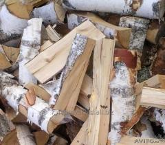 The birch firewood in bulk laid in boxes