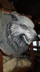 Sculpture for the garden Head of a Wolf on a board