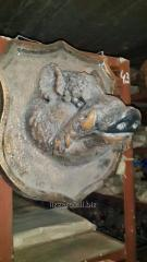 The head of a boar on a board