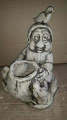 Sculpture the garden Gnome with a bag