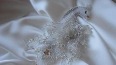 Ornament from beads a brooch a white peacock