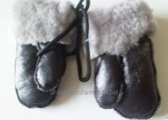 Mittens are children's, leather and knitted,