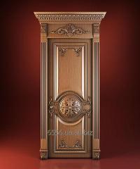 The door is carved, brown