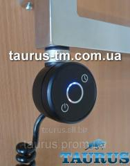 Black elektroten in a sushitel for towels with the