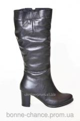 Women's winter leather boots on natural fur.