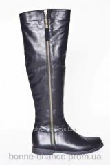 Female winter leather jack boots on natural fur.