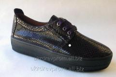 Women's leather gym shoes of a slipona. Model
