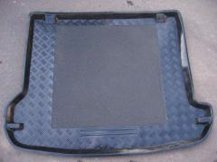Automobile rugs in a luggage carrier with the