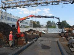 The overloader the manipulator for scrap metal, stationary
