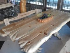 Wooden table for rest and reception of guests