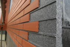 Heat-insulating panels for a facade under a brick