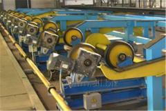 Рольганг для поступательно-вращательного перемещения труб (состоит из рамы, роликоопор холостых, роликоопор приводных, механизма поворота и тяг)