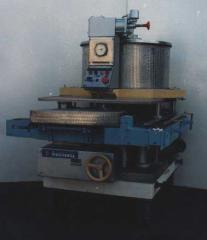 The automatic machine dosing and filling DN3-1-125-2 for filling of cans liquid foodstuff viscosity from 3,0 to 8,0 N of sq. cm