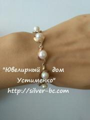 Bracelet with pearls, a silver bracelet with gold